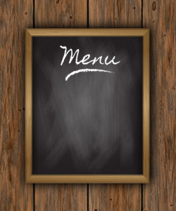 Chalkboard menu on wooden background